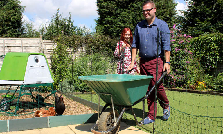 Omlet Chicken Fencing with a man wheeling his wheelbarrow through the gate